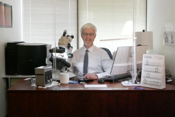 Harold Lindsey behind splash guard - Gem Lab offices
